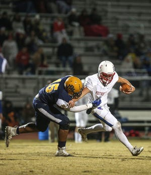 Rocky Mount defensive end Keeshawn Silver (15) is one of many top senior players in North Carolina considering skipping their final prep campaign since season has been moved to spring due to COVID-19 outbreak. (Photo courtesy of Rocky Mount Telegram)