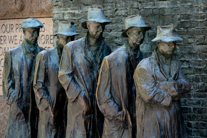 Bronze figures at the Franklin Delano Roosevelt Memorial in Washington, D.C., depict jobless men waiting in a food line during the Great Depression.