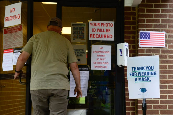 A Hokes Bluff resident opens the door to vote in municipal elections on Tuesday at the Hokes Bluff Community Center.