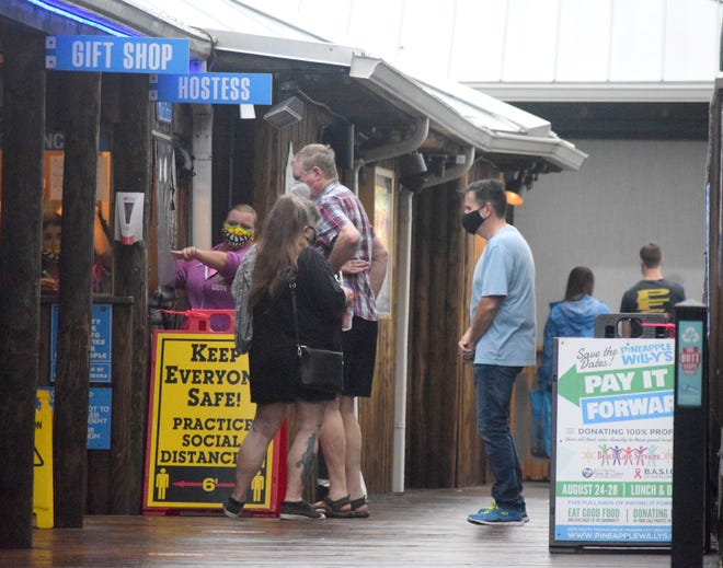 """Customers visit Pineapple Willy's in 2020 during the restaurant's """"Pay it Forward"""" event."""