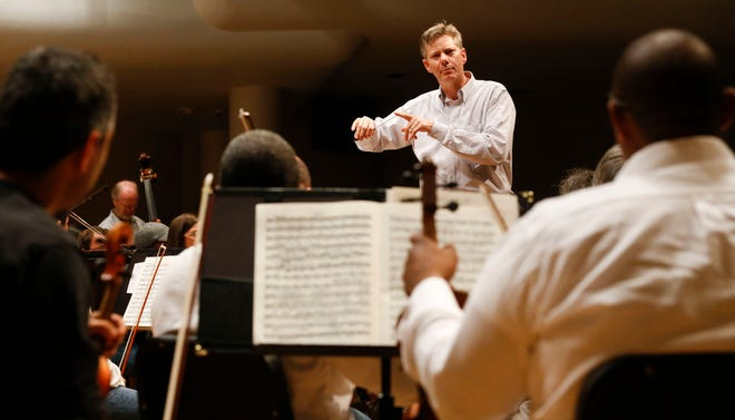 Director Adam Flatt gives instructions during rehearsal for the Tuscaloosa Symphony Orchestra Sunday, Sept. 16, 2018 in Moody Music Hall at the University of Alabama. [Staff Photo/Gary Cosby Jr.]