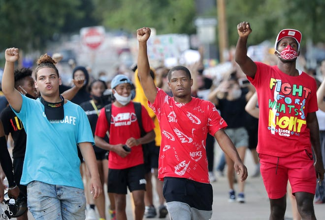 A group of protesters gathered at Houdini Plaza and marched through city streets on Monday, August 24, 2020, Appleton, Wis. Protesters gathered a day after Kenosha, Wis., police shot Jacob Blake, a Black man, in the back at close range.