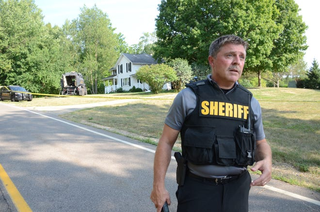 Calhoun County Sheriff discusses a Tuesday afternoon standoff outside Marshall in front of the house where the suspect died.   Trace Christenson/The Enquirer