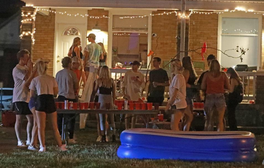 Off-campus yards and porches were crowded on Thursday, Aug. 20, near the Ohio State University campus.  A few masks were visible.  A combination of online and private classes begin Tuesday at Columbus' campus.