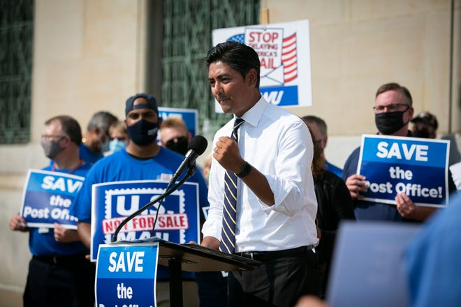 Aftab Pureval, the Hamilton County Clerk of Courts, speaks to members of the media outside of the Cincinnati Post Office, on Dalton Ave., on Tuesday, August 25, 2020.