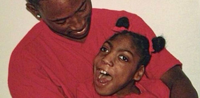 In this family photo provided by the family's lawyer, Timesha Beauchamp is pictured with her brother Steven.