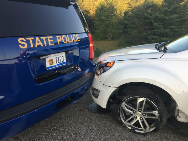 An image provided by Michigan State Police shows a Cadillac Post trooper's vehicle after it was used to stop a driver suffering from a stroke on the U.S. 131 Freeway in Wexford County.