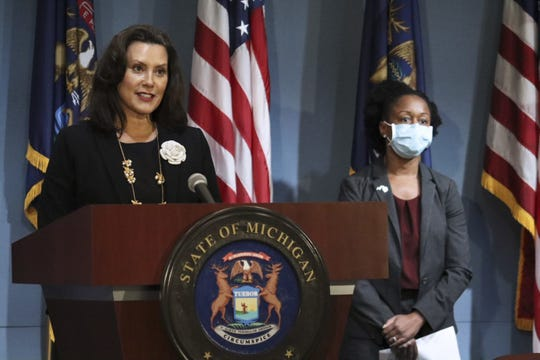 Michigan Governor Gretchen Whitmer, left, speaks as Chief Medical Executive and MDHHS Chief Deputy for Health Dr. Joneigh Khaldun listens during a press conference, Tuesday, August 25, 2020.