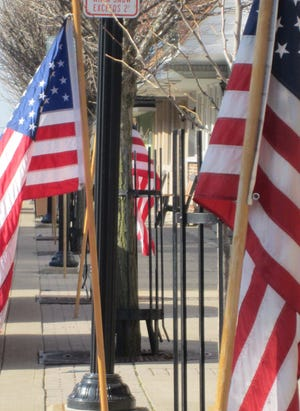 Clyde Career Women members put out dozens of American flags throughout their city for each national holiday and special events.