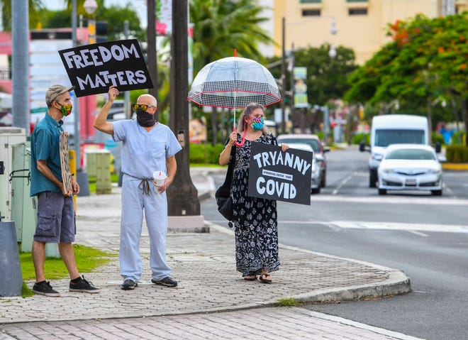 A group of protesters gather along the San Vitores Road in Tumon to express their disapproval for the island shutdown during a peaceful demonstration in this Aug. 25 file photo.