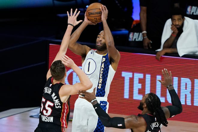 Indiana Pacers' T.J. Warren (1) shoots over Miami Heat's Duncan Robinson (55) during the first half of an NBA basketball first round playoff game Monday, Aug. 24, 2020, in Lake Buena Vista, Fla.