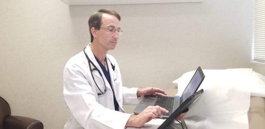 Covenant Health internist Dr. Jeff Boruff demonstrates telehealth services.