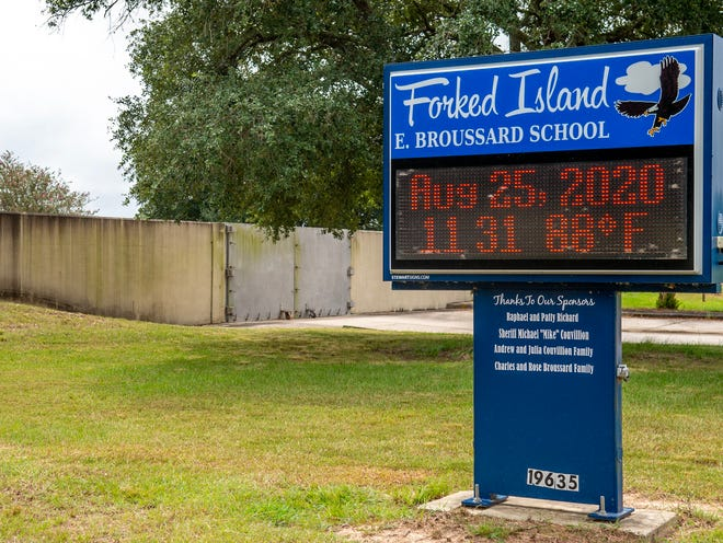 Flood gates at Forked Island E. Broussard in Vermilion Parish have been closed in preparation for Hurricane Laura Tuesday, Aug. 25, 2020. The school also is surrounded by a levee.