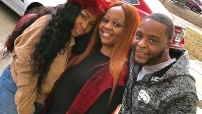 Trayford Pellerin, right, died after Lafayette police shot him Friday night during a confrontation. His sister Treneca Pellerin, far left, set up a GoFundMe page to raise money for the family. Their mother Michelle Pellerin is center.