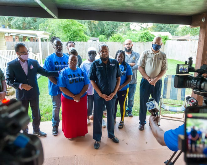 Trayford Pellerin's family holds press conference asking for peaceful protest, condemning violence while asking for justice. Monday, Aug. 24, 2020. Left to right, family attorney Ronald Haley, Kalvin West, Michelle Pellerin, Devon Norman, Cedrik Pellerin, council member Pat Lewis, Choichy Pellerin, Jamal Taylor, and council member Glenn Lazard.