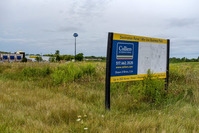 Construction of a mixed-use development ofretail, restaurants and apartments on200 acresalong and north of West Saginaw Highway, photographed on Tuesday, Aug. 25, 2020 is expected to start this year, but its completion hinges on the creation of a special taxing district.
