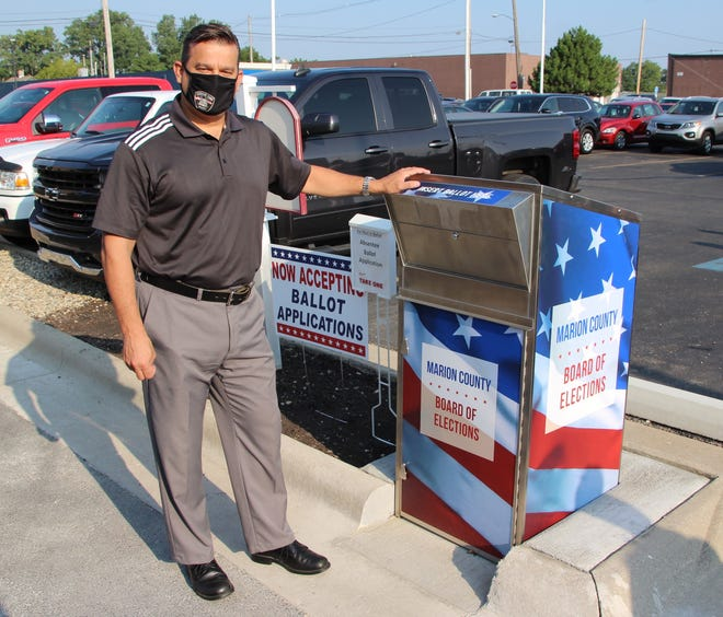 Marion Mayor Scott Schertzer was on hand Tuesday, Aug. 25, 2020, for the unveiling of the new Marion County Board of Elections drop box outside the Marion County Building, 222 W. Center St., Marion. Absentee ballot applications are located in a box next to the drop box.
