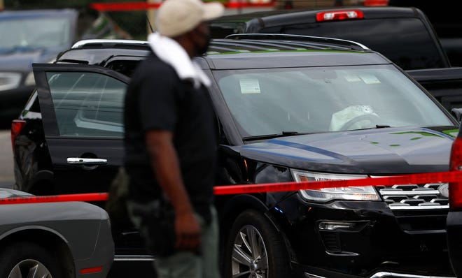 A bullet hole can be seen in the windshield of a black SUV outside the MAPCO near the intersection of East. Alcy Road and Elvis Presley Boulevard in Memphis on Tuesday, Aug. 25, 2020, following an officer-involved shooting in the area.