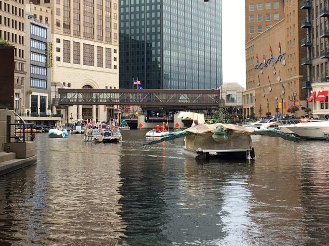 The Milwaukee Riverkeeper Boat Parade makes its way up the Milwaukee River in downtown Milwaukee on Sept. 8, 2019.