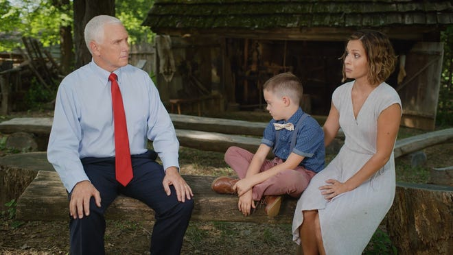 Vice President Mike Pence (left) meets with Sarah Hughes (right) and her 8-year-old son Jack at President Abraham Lincoln's Boyhood National Memorial in Lincoln City, Indiana.