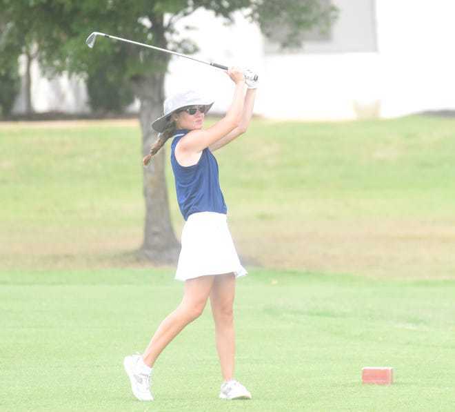 Mountain Home's Madelyn Smith watches her shot during a recent match at Big Creek. The Lady Bombers picked up a victory at Searcy on Monday.