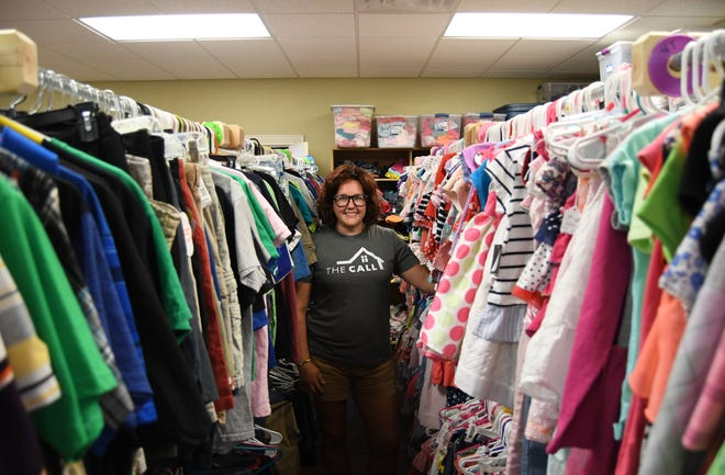 Amanda Wooten, county coordinator for The CALL in Baxter County, stands in the middle of the organization's storeroom at 117 N. College Street in Mountain Home. The organization has outgrown its building and its looking for a larger venue.