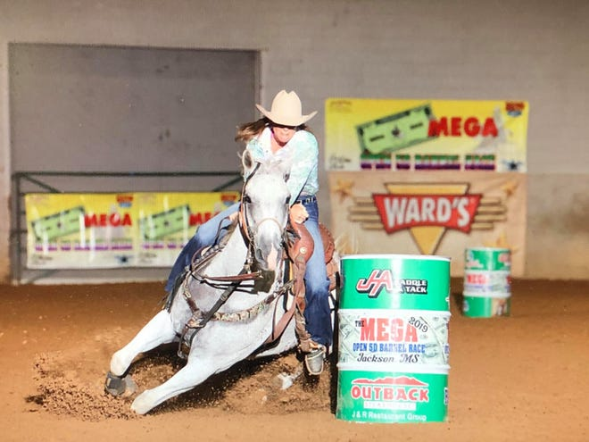 Sam Stallings, a district director in Alabama for the National Barrel Horse Association, is also a barrel racer.