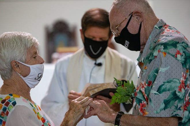 Arlene Carney, exchanges vows with Bill Baumann during their wedding ceremony performed by Father Thoeni, Tuesday, Aug. 25, 2020 at St. Paul's Episcopal Church in East Naples.