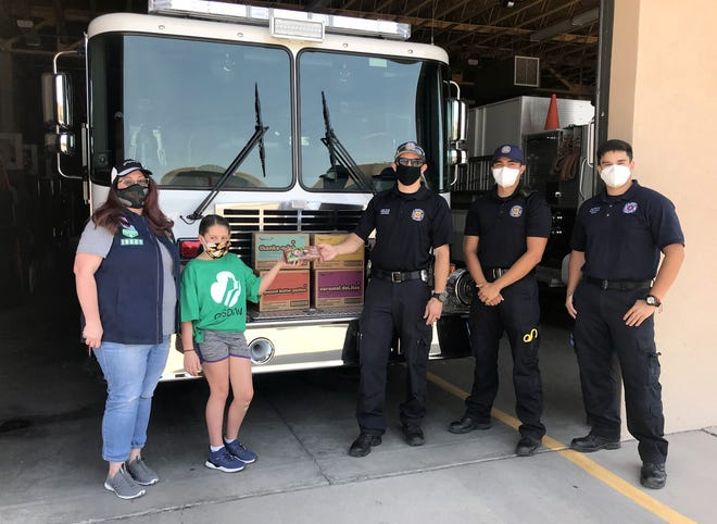 Last year, Deming firefighters were visited by Girl Scout Troop leader Lenadra Stewart and scout Aerona Stewart, 10. The scouts distributed cookie boxes to essential workers and the elderly in assisted living facilities. The scouts also delivered to Lordsburg and Animas.
