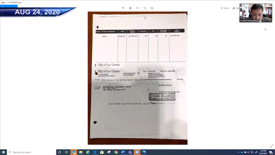 A photocopy of the original check issued to the Professional Assessment Center in 2000 was displayed at an Aug. 24, 2020 city council work session.
