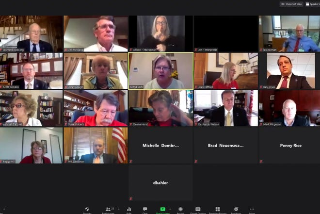 An Associated Press computer screen capture shows the Kansas State Board of Education meeting by Zoom with staff members and other state officials watching, Wednesday, July 22, 2020, in Topeka, Kan. Zoom meeting software is experiencing a partial outage Monday, August 24, 2020 as many students start up online classes. The company said it started receiving reports of people being unable to start and join Zoom meetings around 9 a.m. E.D.T. It has identified the issue causing the problem and working on a fix as of 10:30 a.m., it reported on its status page. (Kansas State Board of Education via AP)