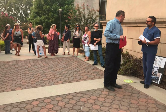 People line up to speak at the Shasta County Board of Supervisors meeting on Tuesday, Aug. 25, 2020, which comes three days after an anti-mask protest at Sprouts Farmers Market on Saturday in Redding.