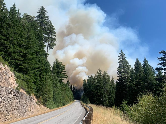 Smoke rises over the White River Fire burning in the Mt. Hood National Forest on Aug 19, 2020.