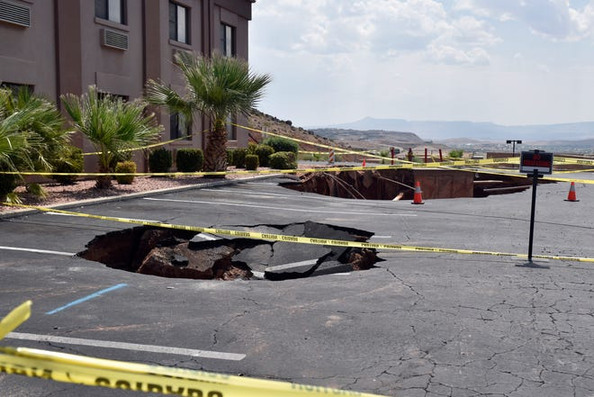 A second sinkhole opened up in the parking lot of the St. George Ramada by Wyndham hotel after damaging rains triggered floods on Aug. 23, 2020.