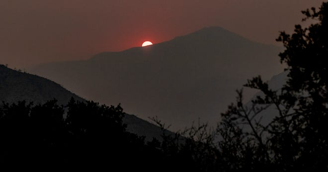 Smoke from California wildland fires obscures the Sun on Monday, August 24, 2020 as seen form Highway 190 east of Springville. Castle Fire burning in Sequoia National Forest is advancing further into the uninhabited Golden Trout Wilderness in the Sequoia National Forest.