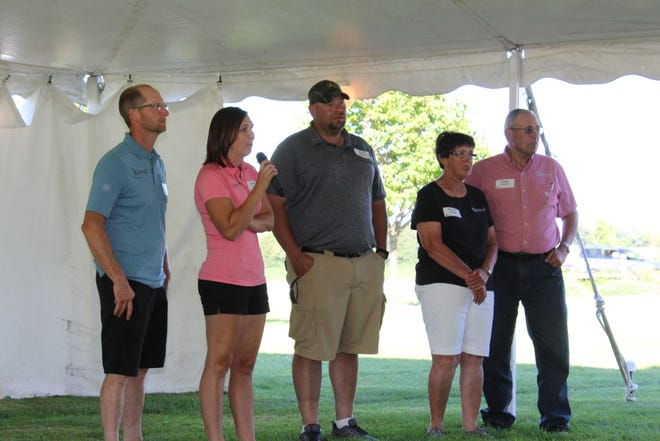 Janet Clark introduces her family during Dairy Fest. Joining her from left, her husband Travis Clark, brother David Grade and parents Sandy and Roger Grade, owners of Vision-Aire Farms.