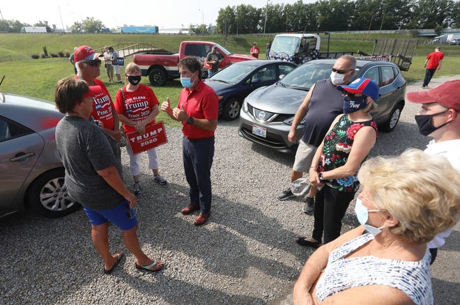 U.S. Representative Troy Balderson speaks to a group of constituents after a rally in support of President Trump at American Pride in Zanesville on Tuesday.