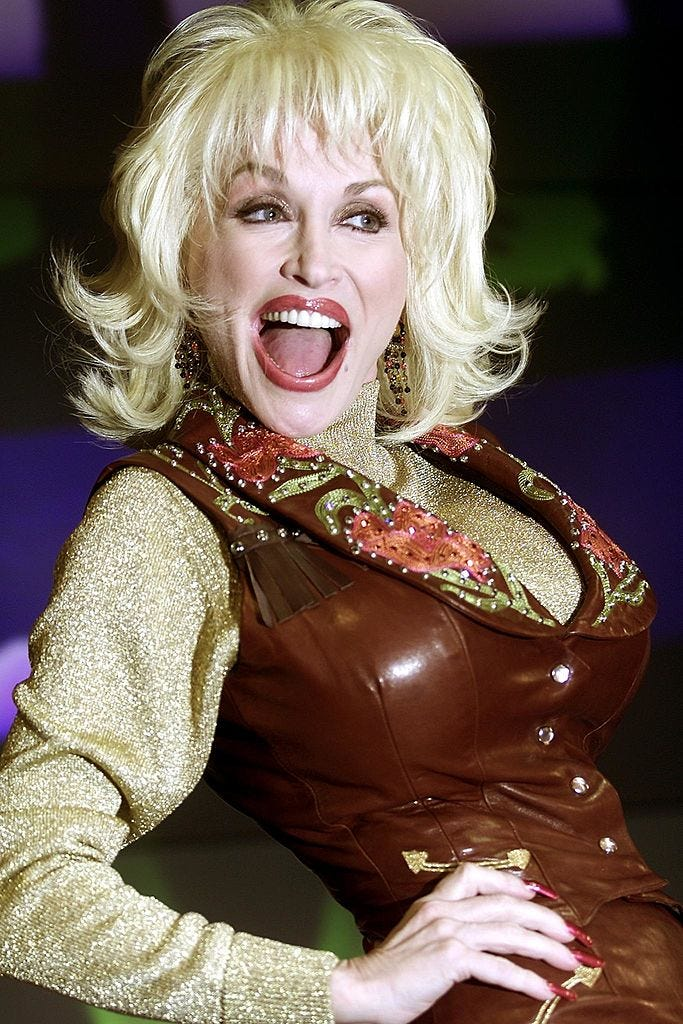 """Dolly Parton poses February 16, 2001, during the launch of her new album """"Little Arrow"""" in a London record store."""