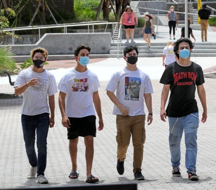 Students arrive at the Student Union at the University of Central Florida, in Orlando, Monday, August 24, 2020, on the first day of classes with new safety protocols in place to fight the coronavirus pandemic.
