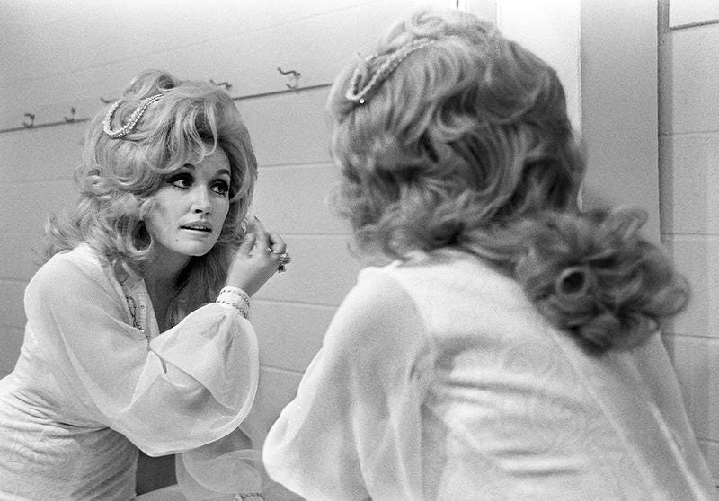 Dolly Parton prepares backstage for an RCA Records breakfast and show at the Nashville Municipal Auditorium in 1973.