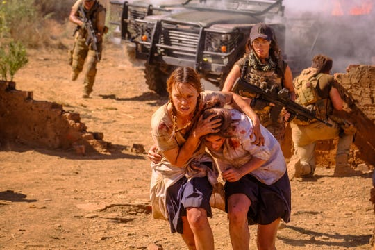 "Megan Fox (middle) stars in the action thriller ""Rogue"" as a mercenary leader hired to rescue hostages (Jessica Sutton and Calli Taylor) from an army of African rebels."