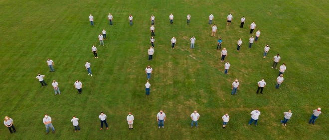 Mahoning County Junior Fair Board members posed for a group photo, making sure to maintain social distancing, with all members wearing masks. The photo was taken by Jim Moore, who used a drone.