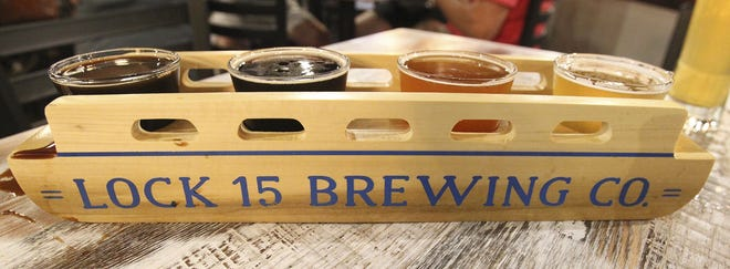 A flight of beers come in a server shaped like a canal boat at the Lock 15 Brewery Thursday, Sept 13, 2018 in Akron, Ohio.   [Karen Schiely/Beacon Journal/Ohio.com]