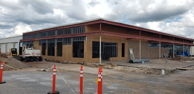 The former Orscheln building at Thompson Square is currently under renovation. Once complete, it will look like the rest of the renovated spaces and contain a doctor's office and eight additional spaces for new business.