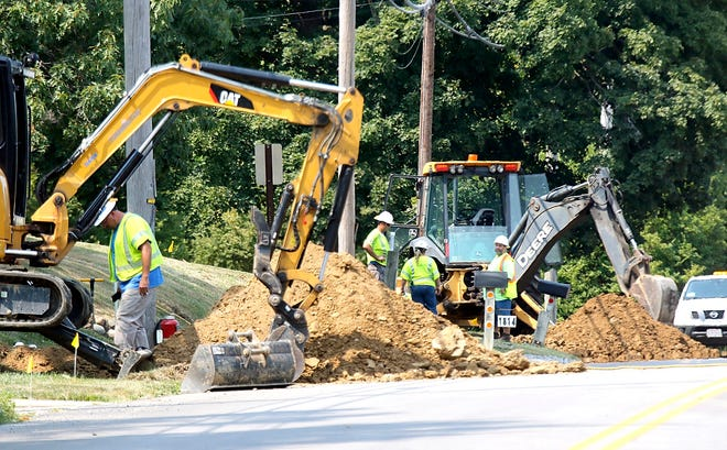 Crews work on a gas leak in the 1700 block of Cottage Street along the east side of the road Wednesday afternoon. A portion of Cottage Street was closed while crews worked on repairing the damage.