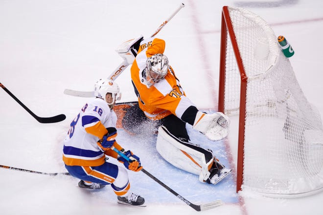 Flyers goalie Carter Hart makes the save on the Islanders' Anthony Beauvillier during Game 2 on Wednesday afternoon.