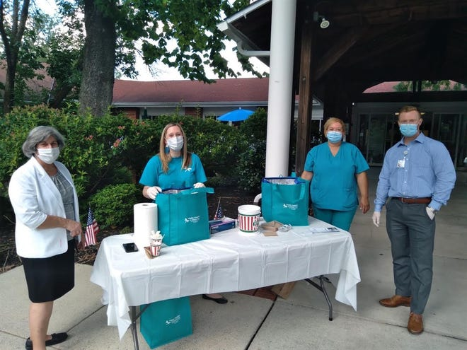 Vitality Hospice employees give away free Rita's at a Burlington County nursing home.
