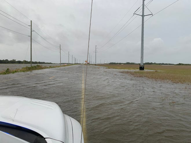 Portions of La. 1 were under water Wednesday as Hurricane Laura approached.