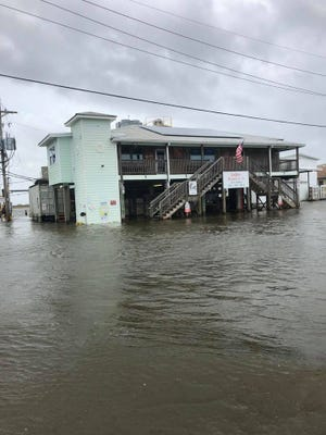 Water rises in south Lafourche Wednesday as Hurricane Laura approaches.