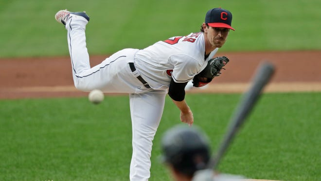 Cleveland Indians starting pitcher Shane Bieber delivers to Minnesota Twins' Max Kepler in the first inning in a baseball game, Tuesday, Aug. 25, 2020, in Cleveland.